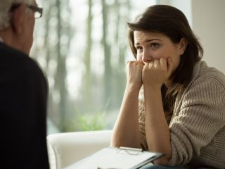 Young women with depression listen her therapist